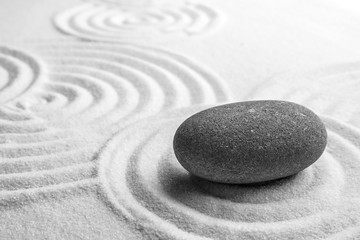 Foto auf Acrylglas Zen-Steine in den Sand Grey stone on sand with pattern, space for text. Zen, meditation, harmony