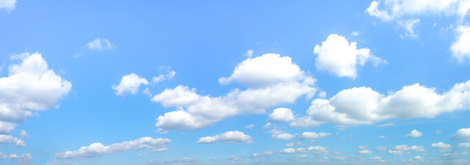 Panorama or panoramic photo of blue sky and clouds or cloudscape.