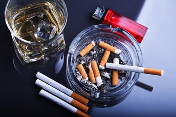 Ashtray and cigarettes. Tobacco smoking.