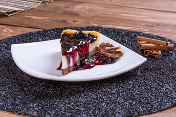 Blueberry cheesecake on wooden table.