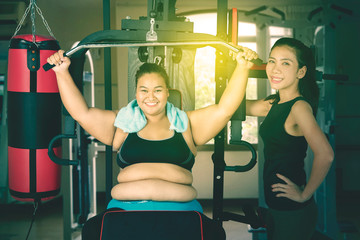 Two women instructing a workout in a gym