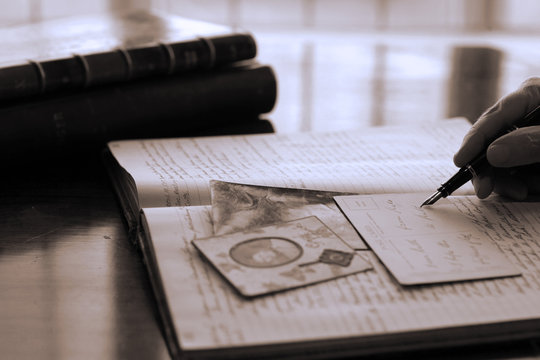 Writing in Journal by a window, sepia