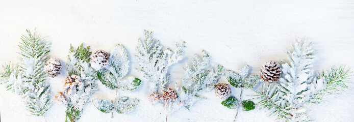 Winter and Christmas themed banner with snowy fir branches, headline