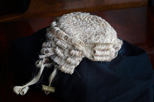 Barrister's wig and Gown on table