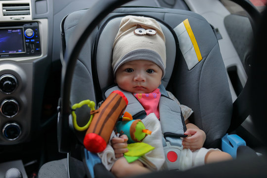 cute baby boy sitting on car seat safety belt lock protection for drive road trip