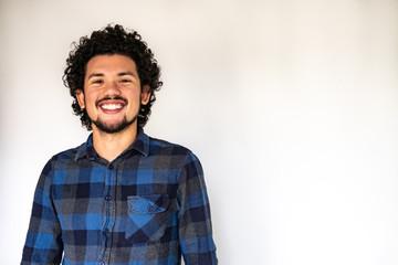 Latin American man smiling, neutral background