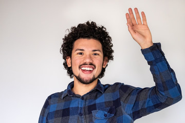 Latin American man, have a question expression, raising a hand