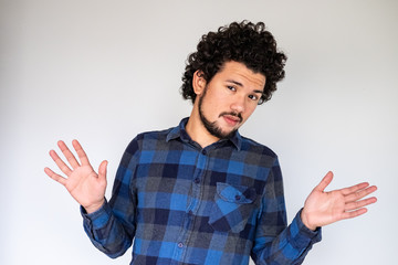 Latin American man, looking cocky, neutral background