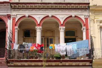 Architecture of Havana - Cuba with colorful fresh laundry on the balcony, Paseo de Marti Street