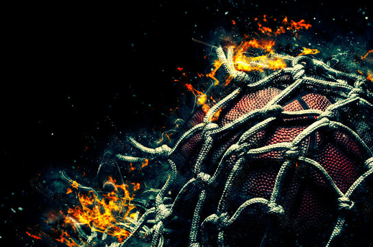 Basketball ball on black background with fire