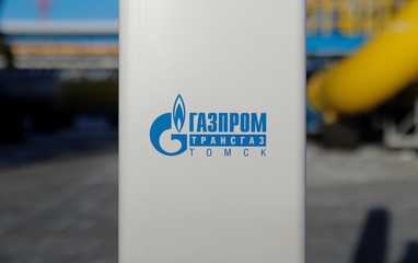 A logo of Gazprom Transgaz Tomsk is pictured at the Atamanskaya compressor station, facility of Gazprom's Power Of Siberia project outside the far eastern town of Svobodny