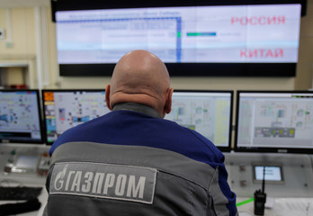 Gazprom employee is pictured in the control room at the Atamanskaya compressor station, part of Gazprom's Power Of Siberia project outside the far eastern town of Svobodny