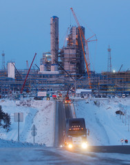 A truck drives in front of the facilities of Amur gas processing plant under construction, part of Gazprom's Power Of Siberia project outside the far eastern town of Svobodny