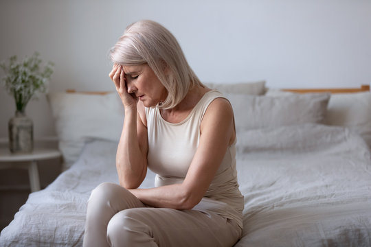 Aged woman feels unwell suffers from barometric pressure headache