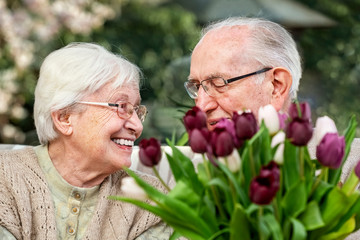 Elderly Couple With a Bouquet of Tulips