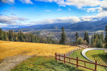Foto auf Acrylglas Khaki ZAKOPANE, POLAND - NOVEMBER 06, 2019: View of the city of Zakopane from Gubalowka, Poland, Europe. Gubalowka mountain is a popular tourist attraction, offering views of the Tatras and Zakopane.