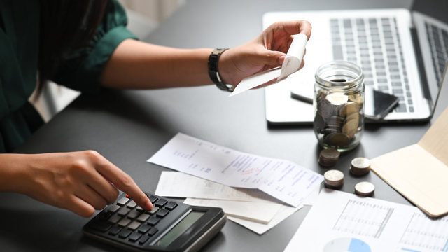 Financial planning concept, Closeup woman calculate billing with finance home saving.