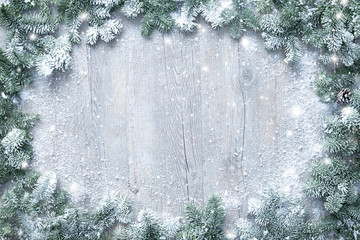 Wall Mural - Christmas and New Year background with fir branches and snowfall