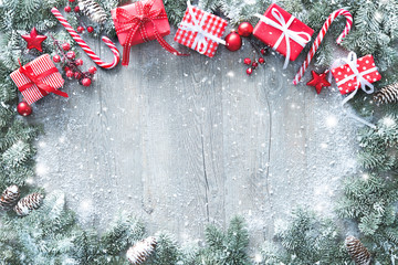 Wall Mural - Christmas and New Year background with fir branches, gift boxes, ornament and snowfall