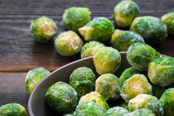 frozen brussels sprouts falling out from the bowl