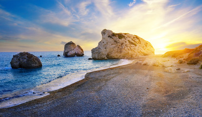 Poster de jardin Chypre Aphrodite's beach and stone at sunset in bright sunshine