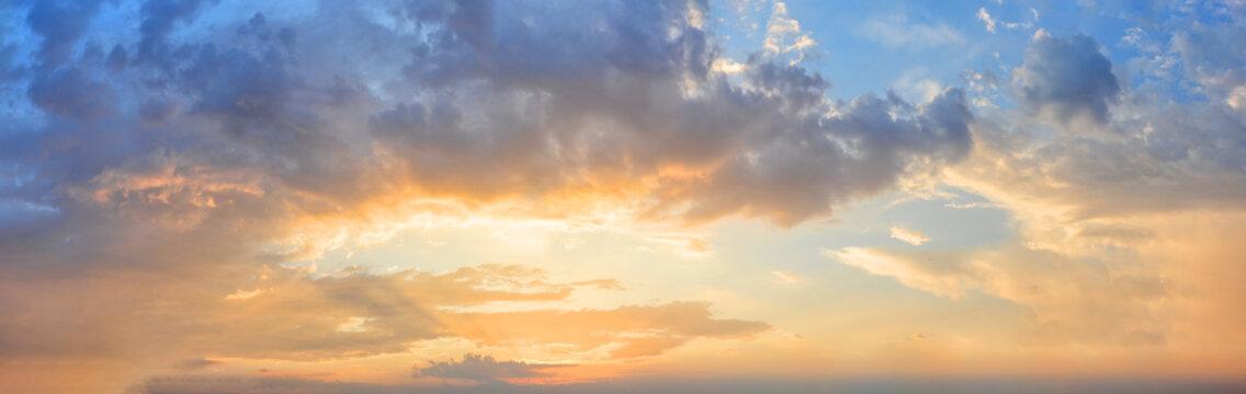 Panorama of orange sunset sky