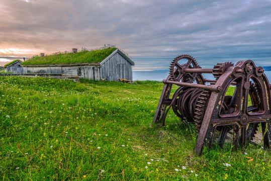Vestiges of the portal mechanism and all building in abandoned fisher's village Hamningberg in Varanger Peninsula of Norwegian Finnmark.