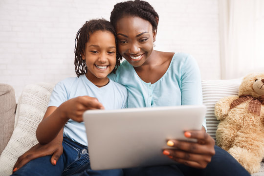 Afro mom and daughter making video call