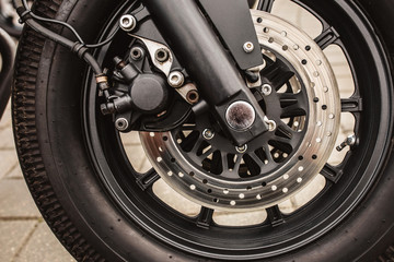 Fork with shock absorbers and motorcycle brake system - fastening the wheel to the suspension