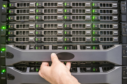 Install a protective panel on a powerful server. Maintenance of computer equipment in the server room of a data center. A platform for hosting databases.