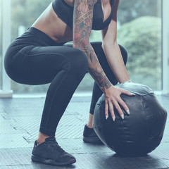 strong healthy sportswoman with medicine ball,