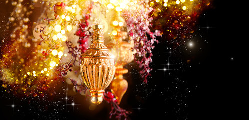 Christmas and New Year Golden Decoration. Abstract Blurred Bokeh Holiday Background with beautiful...