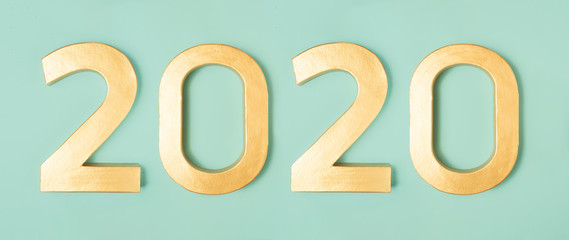 2020 new year eve top view new year number on neon mint background, banner template.