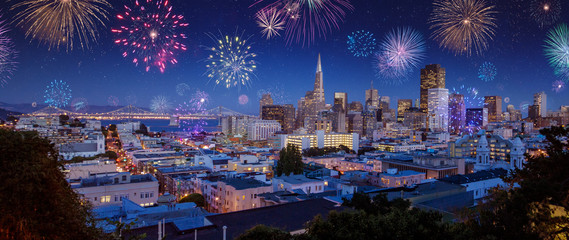 Downtown San Francisco cityscape with Bay Bridge in a bright night/late sunset
