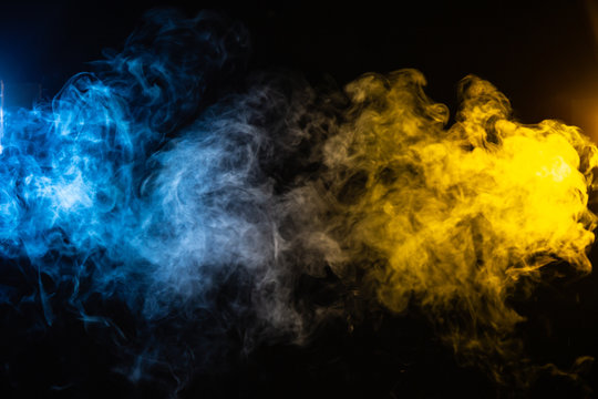 abstract blue and yellow smoke background with space for text