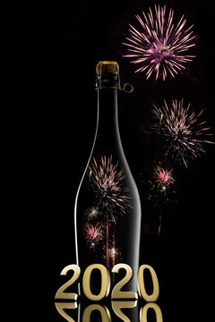 New Year concept.Champagne wine bottle 2020 on black background