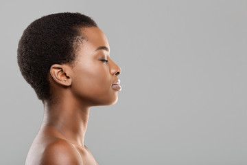 Fototapete - Profile portrait of black woman with perfect skin and closed eyes