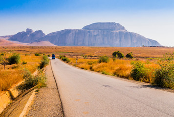 Madagascar, scenic view of Route Nationale 7 (RN7), with Cardinal's hat in background, huge granite mountain forming part of Andringitra massif