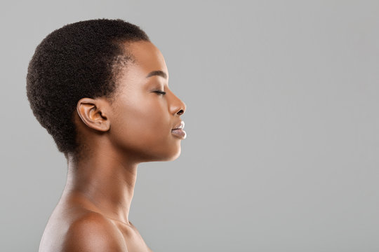 Profile portrait of black woman with perfect skin and closed eyes