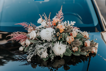 Toned photo of Fresh flowers on the car.