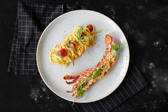 Pasta with lobster, tomatoes and basil. Grilled lobster with cheese.