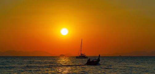 Long tail boat summer golden sunset