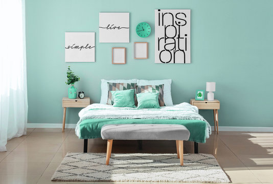 Stylish interior of bedroom in turquoise color