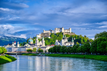 A view of the Austrian city of Salzburg along the Salzach River. Wall mural