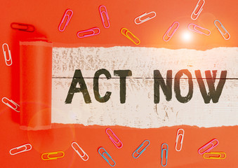 Text sign showing Act Now. Business photo text do not hesitate and start working or doing stuff right away Paper clip and torn cardboard placed above a wooden classic table backdrop