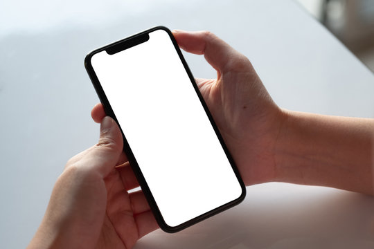Top view Woman sitting and holding blank screen mock up mobile phone