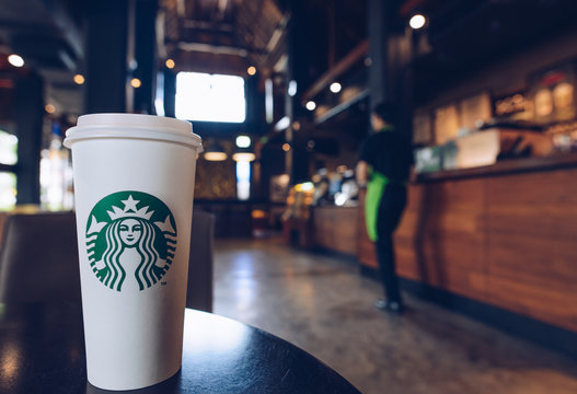 CHIANG MAI, THAILAND- July-24-2017 : A cup of Venti size Starbucks hot coffee in the shop of Starbucks Lanna style of Chiang Mai the northern province of Thailand.