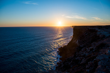 Sunset from the cliff, clear blue sky with sunset, silhouette of the cliff in the front (Western Australia, Australia, 2019)