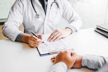 Doctors and patients consulting and diagnostic examining sit and talk. At the table near the window in the hospital medicine concept