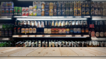 Abstract blur wine bottles on liquor alcohol shelves in supermarket background